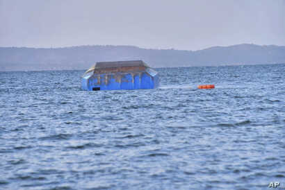The upside-down-turned passenger ferry MV Nyerere floats in the water near Ukara Island in Lake Victoria, Tanzania, Sept. 21, 2018, after it capsized.