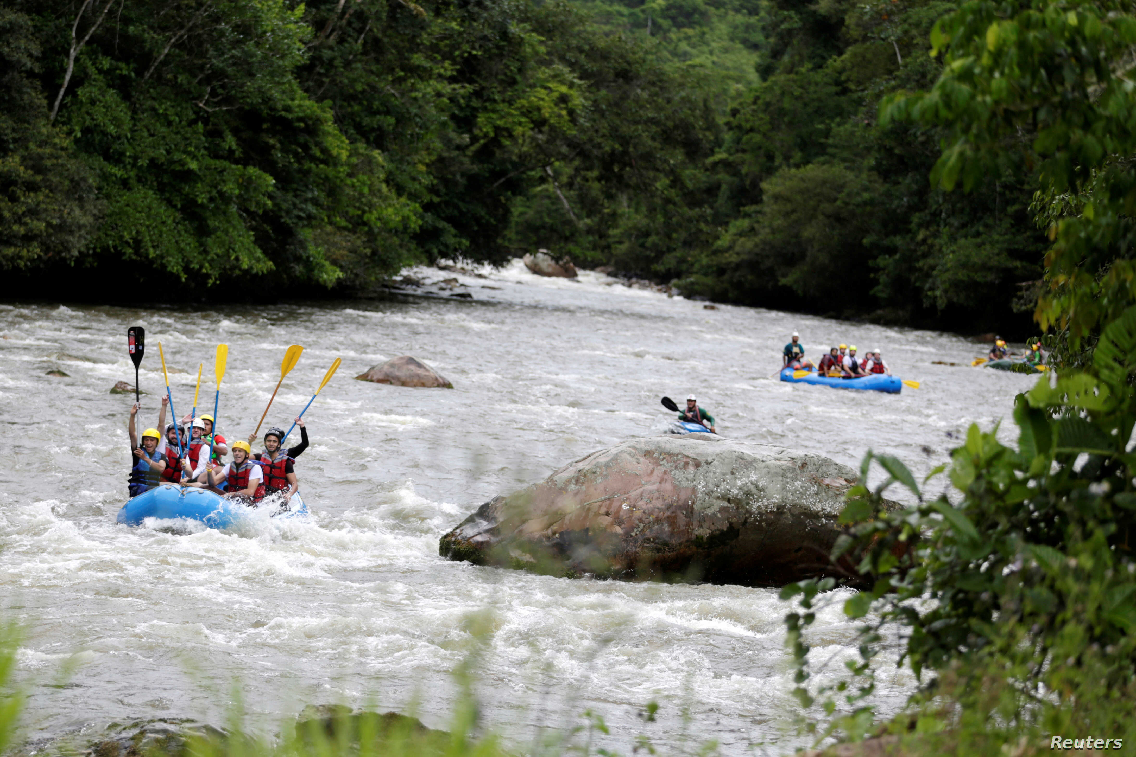 A group of the press and government representatives practice rafting guided by ex-FARC rebels in Miravalle, Colombia, Nov. 9, 2018.
