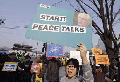 FILE - South Korean protesters stage a rally opposing a visit of U.S. Secretary of State Rex Tillerson as they wait for his arrival in front of the government complex in Seoul, March 17, 2017