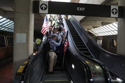 White nationalist leader Jason Kessler arrives at Vienna Metro Station, while travelling to participate in a rally marking the one year anniversary of the 2017 Charlottesville 'Unite the Right' protests, in Vienna, Virginia, Aug. 12, 2018.