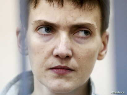 Ukrainian military pilot Nadezhda Savchenko looks out from a defendants' cage during a court hearing in Moscow, Russia, May 6, 2015.