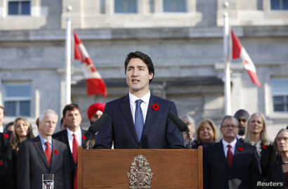 Canadian Prime Minister Justin Trudeau speaks to the crowds outside Rideau Hall after the Cabinet's swearing-in ceremony in Ottawa, Nov. 4, 2015.