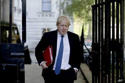 Britain's Foreign Secretary Boris Johnson arrives for a cabinet meeting at 10 Downing Street in London, Tuesday, May 1, 2018.
