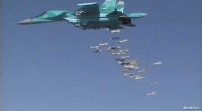 FILE - A still image, taken from video footage and released by Russia's Defence Ministry on Aug. 18, 2016, shows a Russian Sukhoi Su-34 fighter-bomber based at Iran's Hamadan air base, dropping bombs in the Syrian province of Deir Ezzor.