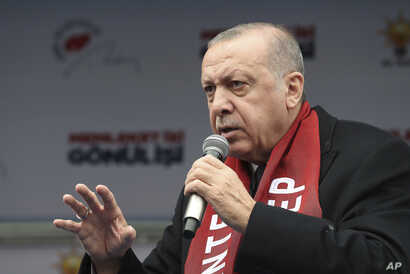 Turkey's President Recep Tayyip Erdogan addresses supporters of his ruling Justice and Development Party (AKP), during a rally in Gaziantep, Turkey, March 15, 2019.