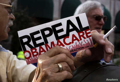 FILE - A small group of demonstrators denouncing Obamacare.