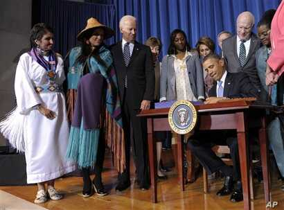 President Barack Obama signs Violence Against Women Act, Interior Department, Washington, March 7, 2013.