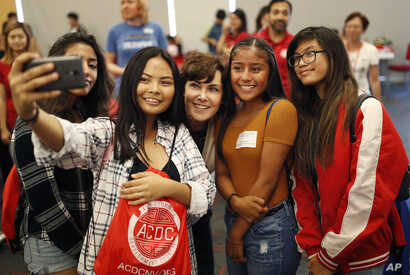 Rep. Jacky Rosen, D-Nev., center, poses for a selfie with high school students at an event put on by the Asian Community Development Council in Las Vegas, Sept. 29, 2018. In the high-stakes race for Senate in Nevada, Rosen is taking on one of the big...