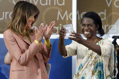 Godelieve Mukasarasi of Rwanda, holds up her award presented by first lady Melania Trump at the 2018 International Women of Courage awards, March 23, 2018, at the State Department in Washington. Mukasarasi helped the first criminal prosecution of rap...