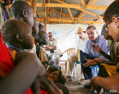 Rep. Chris Smith, R-NJ and Rep. Karen Bass, D-CA talk to South Sudanese children from refugee camps during a trip in May of 2017.