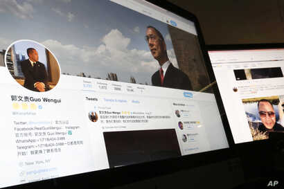 A Twitter page of Chinese exiles businessman Guo Wengui is seen on a computer screen in Beijing. Escalating efforts to repatriate one of its most wanted exiles, China's ruling Communist Party has opened a police investigation on a new allegation, r...