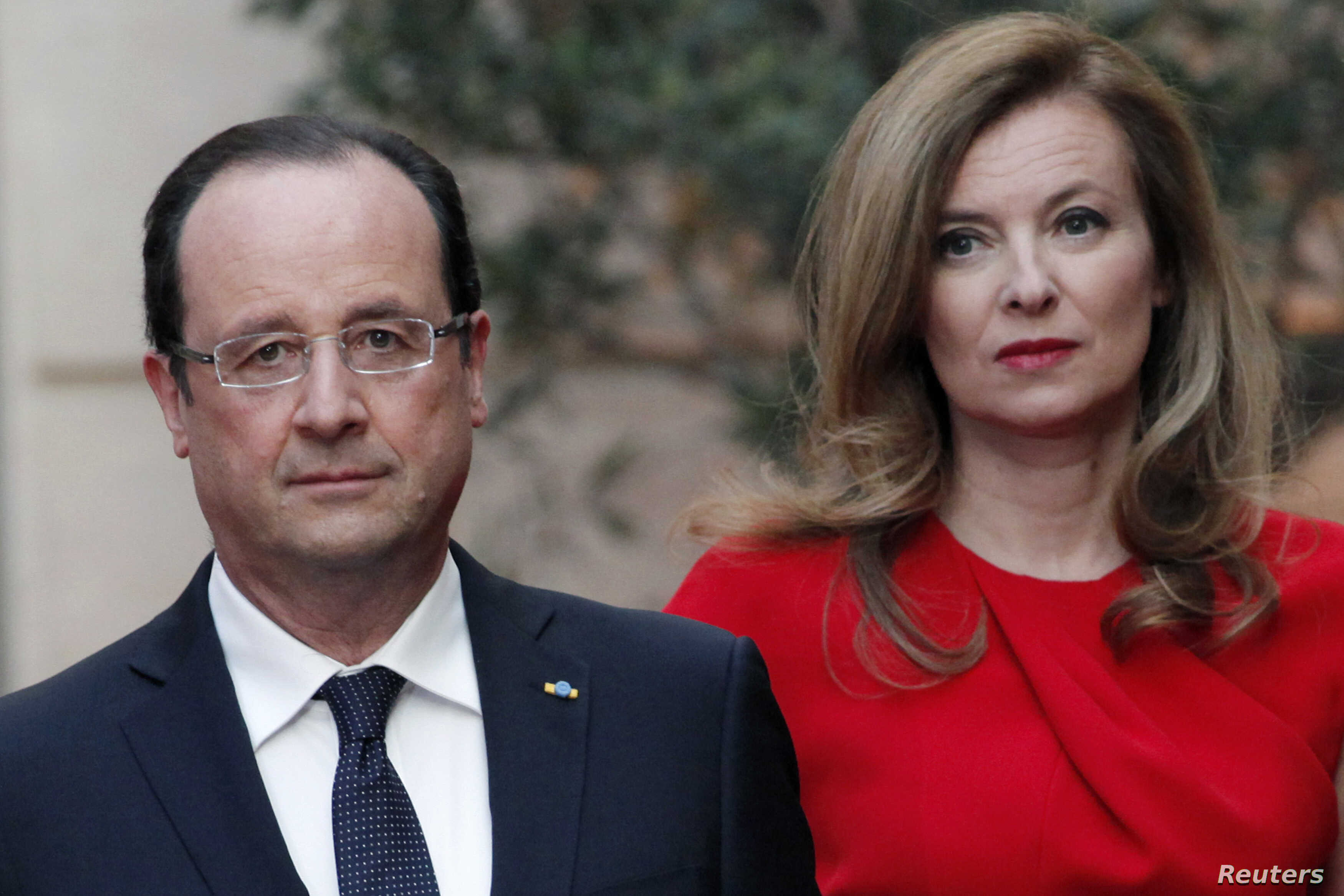 FILE - French President Francois Hollande (L) and his former-companion Valerie Trierweiler arrive for a state dinner at the Elysee Palace in Paris.