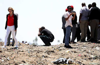 United Nations workers mourn their colleagues during a commemoration ceremony for the victims of the Ethiopian Airlines plane crash, near Addis Ababa, Ethiopia, March 15, 2019.