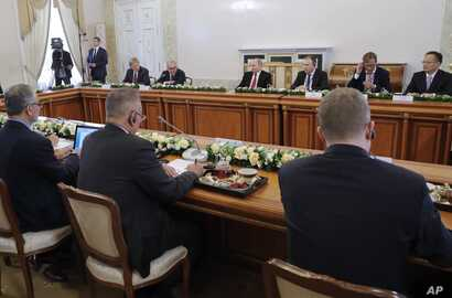 Russian President Vladimir Putin, fourth right in the back, meets with heads of international news agencies at the St. Petersburg International Economic Forum in St. Petersburg, Russia, June 1, 2017.