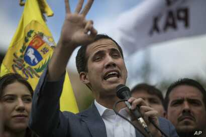 Venezuela's self-declared interim leader Juan Guaido speaks to supporters in a public plaza in Las Mercedes neighborhood of Caracas, Venezuela, Jan. 26, 2019.