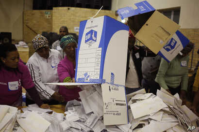 Election officials start the ballot-counting process at a polling station during municipal elections in Manenberg on the outskirts of Cape Town, South Africa, Aug. 3, 2016.