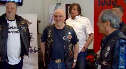 Daniel Baud, second from left, and members of the Bastille Harley owners group. (L. Bryant/VOA)
