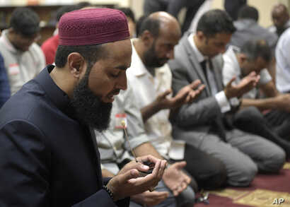 Imam Azhar Subedar, left, speaks during a special interfaith prayer service at the American Muslim Community Center in Longwood, Florida, June 13, 2016, to support the Orlando shooting victims.