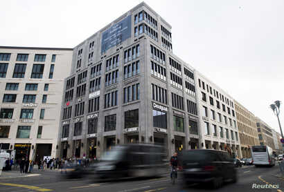 Cars drive by the recently finished Mall of Berlin shopping center in Berlin, Germany, Sept. 25, 2014.