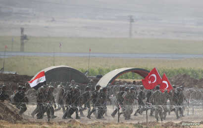 Turkish and Iraqi troops participate in a joint military exercise near the Turkish-Iraqi border in Silopi, Turkey, Sept. 26, 2017.