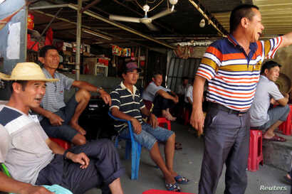 Villagers gather to discuss the recent arrest of their democratically elected village chief Lin Zulian, in the southern Chinese fishing village of Wukan June 20, 2016.