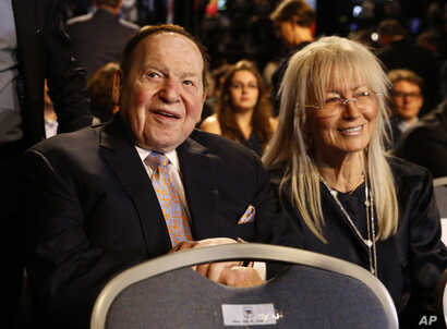 Sheldon Adelson sits with his wife Miriam waits for the presidential debate between Democratic presidential nominee Hillary Clinton and then-Republican presidential nominee Donald Trump at Hofstra University in Hempstead, N.Y., Monday, Sept. 26, 2016...