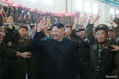 FILE - North Korean leader Kim Jong Un reacts with scientists and technicians of the DPRK Academy of Defense Science after the test-launch of the intercontinental ballistic missile Hwasong-14 in this undated photo released by North Korea's Korean Cen...