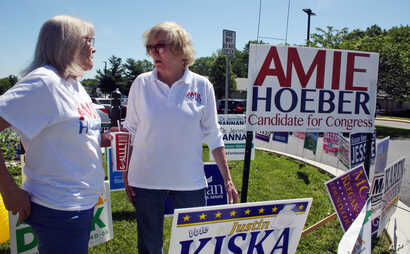 Amie Hoeber, right, a Republican who is running in the Maryland 6th Congressional District primary, talks to a supporter at an early voting center in Frederick, Md., June 14, 2018.