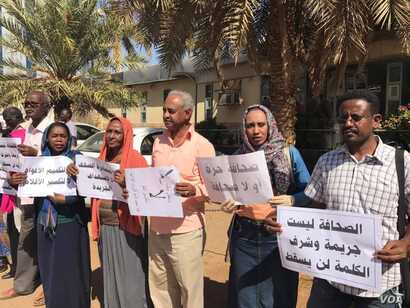 Journalists took to the streets in Khartoum, Sudan, demanding that the government respect their constitutional rights of freedom of speech and of the press, Dec. 29, 2016.