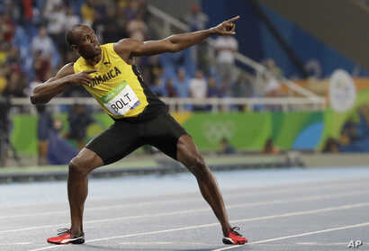 FILE - Usain Bolt celebrates winning the gold medal in the men's 200-meter final at the Summer Olympics in Rio de Janeiro, Brazil, Aug. 18, 2016.