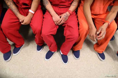FILE - Detainees are seen at the Adelanto immigration detention center, run by Geo Group Inc, in Adelanto, California, April 13, 2017.