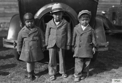 "Left to right: Newton Poolaw (Kiowa), Jerry Poolaw (Kiowa), Elmer Thomas ""Buddy"" Saunkeah (Kiowa). Mountain View, Oklahoma, ca. 1928. 57FK1. © 2014 Estate of Horace Poolaw.  Reprinted with permission."