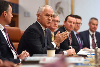Australian Prime Minister Malcolm Turnbull speaks to state and territory leaders during a meeting of the Council of Australian Governments at Parliament House in Canberra, Australia, Oct. 5, 2017.