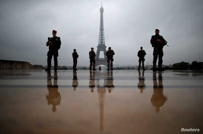 """French soldiers patrol near the Eiffel Tower as part of the """"Sentinelle"""" security plan in Paris, France, May 3, 2017."""