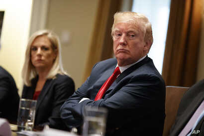President Donald Trump listens during a meeting with law enforcement officials on the MS-13 street gang and border security, in the Cabinet Room of the White House, Feb. 6, 2018.