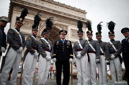 West Point cadets pose before a commemoration ceremony for Armistice Day, 100 years after the end of the First World War at the Arc de Triomphe in Paris, France, Nov. 11, 2018.