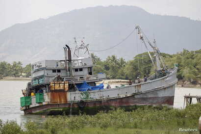 The boat that was found at sea carrying migrants is seen near Kanyin Chaung jetty after landing outside Maungdaw township, northern Rakhine state, Myanmar, June 3, 2015.