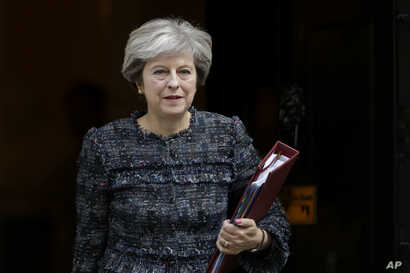 British Prime Minister Theresa May leaves 10 Downing Street in London, to attend Prime Minister's Questions at the Houses of Parliament, Sept. 13, 2017.
