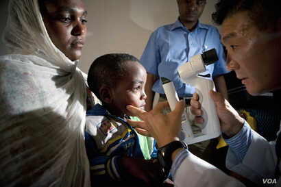 FILE - Screening of a pediatric patients by Dr. Donny Suh in Gondar, Ethiopia, Oct. 2012.  Dr. Suh is a cataract and strabismus specialist from Des Moines, Iowa.