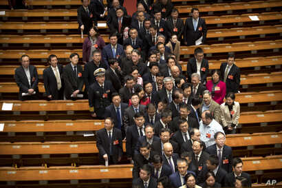 Delegates leave after the closing session of the Chinese People's Political Consultative Conference (CPPCC) at the Great Hall of the People in Beijing, March 13, 2019.