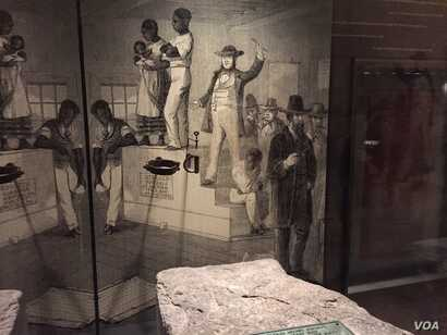 A stone slave auction block from Hagerstown, Maryland, is displayed at the Smithsonian National Museum of African American History & Culture in Washington, D.C. (C. Simkins/VOA)
