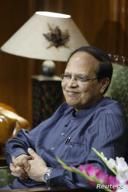 Bangladesh's central bank Governor Atiur Rahman smiles during an interview inside his office in Dhaka, October 2, 2013.