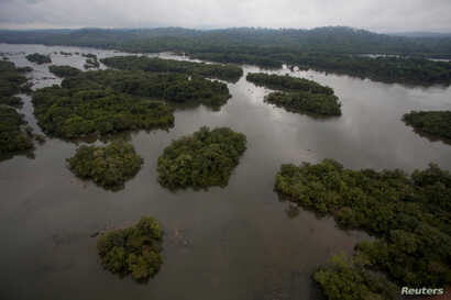 FILE - A view of the section of the Xingu River being flooded by the building of the Belo Monte hydroelectric dam, planned to be the world's third largest, in Pimental, near Altamira in Para state, Nov. 23, 2013.