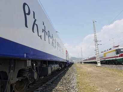 Locomotives for the new Ethiopia to Djibouti electric railway system sit outside a train station in the outskirts of Addis Ababa, Sept. 24, 2016.