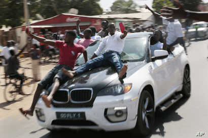 Gambians celebrate the victory of opposition coalition presidential candidate Adama Barrow in the streets of Serrekunda, Gambia, Dec. 2, 2016.