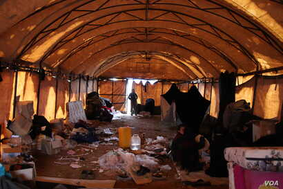 Al-Hol camp does not have enough small tents to house new arrivals, so many crowd into larger spaces that are generally dirty, cold and unsafe for children on March 4, 2019 in al-Hol Camp, Syria.