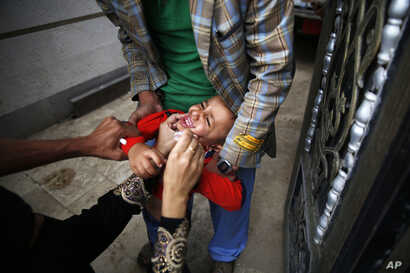 A boy receives a polio vaccination during a polio immunization campaign in Sana'a, Yemen, Aug. 15, 2015.