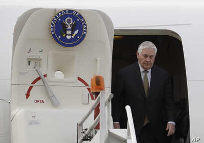 U.S. Secretary of State Rex Tillerson exits his plane as he arrives in Mexico for a two-day visit, at Benito Juarez airport in Mexico City, Feb. 1, 2018.