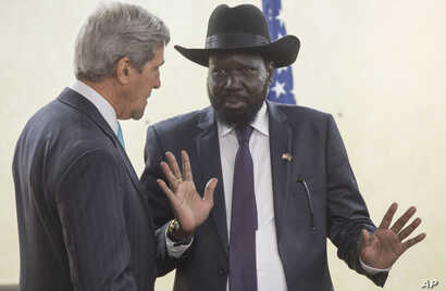 South Sudan's President Salva Kiir, right, chats with U.S. Secretary of State John Kerry as he greets Kerry at the President's Office in Juba, South Sudan, Friday, May 2, 2014. Kerry is urging South Sudan's warring government and rebel leaders to uph...