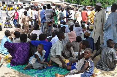 Civilians who fled their homes following an attacked by Islamist militants in Bama, take refuge at a School in Maiduguri, Nigeria, Wednesday, Sept. 3, 2014. A Nigerian senator says thousands of people are fleeing a northeastern city amid conflicting ...